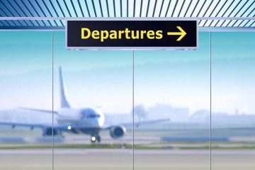 Departures sign indicating overseas travel