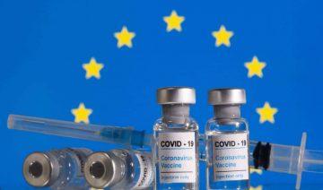 EU logo with vaccines indicating a  green pass scheme