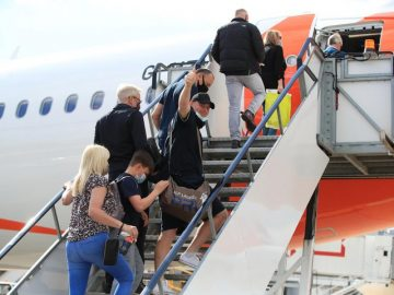 passengers boarding plane to a green list country