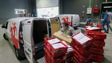 CTT vams being loaded with parcels