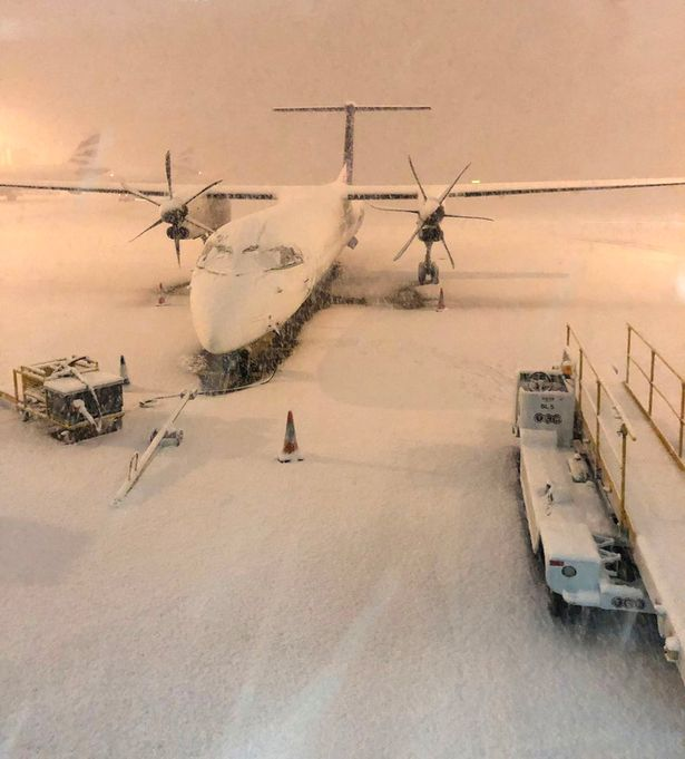 Plane at Manchester Airport, closed by snow